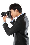 Photographe utilisant l'appareil-photo de dslr Photo libre de droits