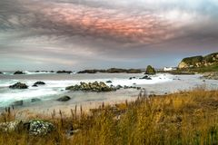 This photographe was taken at sunset on the beach near Ballintoy Harbor.  royalty free stock photography