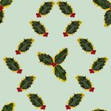 Photographed holly leaves and berries, arranged as simple regular pattern on light green background. Seamless photograph to be repeated endlessly. Great for Stock Image