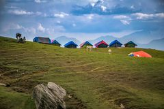 Photographed of Lined Tents on Green Grass Hills royalty free stock photos