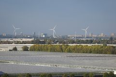 View of windmills and greenhouses in the western part of The Netherlands, near Rotterdam and The Hague. stock images