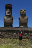 Photographed Moai. Easter Island: Moai being photgraphed by a tourist Royalty Free Stock Images