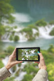 Photographed Plitvice Lakes with tablet Stock Photo