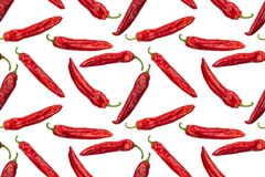 Seamless image of photographed red paprika peppers. Photographed red paprika peppers on a white background.  Seamless image to be repeated endlessly. Great for Stock Photo