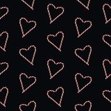 Photographed red and white traditional Christmas heart shaped candy cane on black background sealess pattern vector illustration