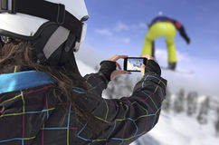 Photographed snowboarder jump with smart phone Royalty Free Stock Photos