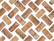 Photographed wine corks on a white backlit background. Grouped as pattern, seamless, to be repeated endlessly. Great for printed wallpaper, fabric, wrapping royalty free stock image