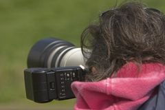 Photographer. Image of photographer taking a picture with high-end equipment Stock Images