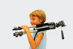 Photographer. Lovely Young Photographer With Tripod Against White Background Stock Image