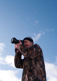 Photographer. Professional photographer in hunting clothing shot something Stock Image