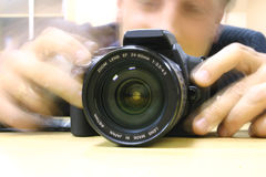 A photographer. With digital optical camera in his hands Stock Images