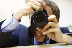 A photographer. With a camera in his hands Royalty Free Stock Photo
