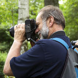 Photographer. A photographer at work in a park stock photography