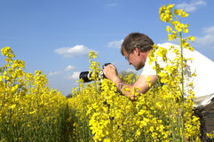 Photographer. Is taking a landscape photo Stock Photography