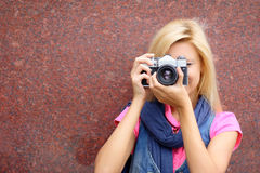 Photographer. With old camera on a background of a wall Royalty Free Stock Photos