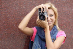 Photographer. With old camera on a background of a wall Royalty Free Stock Images
