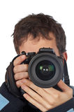 Photographer. Teenager photographer holding and looking into a camera Royalty Free Stock Images