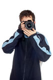 Photographer. Teenager photographer holding and looking into a camera Stock Photo