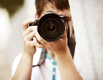 Photographer. Natural light, selective focus point on nearest part of lens Royalty Free Stock Images