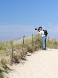 The photographer 2. Photographer at work on a Dutch beach/dunes Stock Photo
