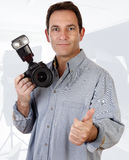 Photographer. Portrait of a mature man on forties, holding a camera Royalty Free Stock Photography