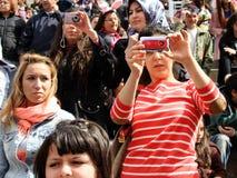 Photographer. Music fans records the show during Bengu Erden Concert at Marmara Egitim Kurumlari on April 23, 2011 in Istanbul, Turkey Royalty Free Stock Image
