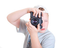 Photographer. Boy with a camera on a white background Royalty Free Stock Image