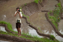 Photographer. Shooting locals in the paddy fields in Bali, Indonesia Stock Images