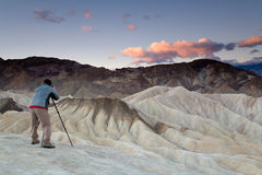 Photographer. Landscape photographer taking pictures at sunrise in Death Valley national park in California Stock Photo