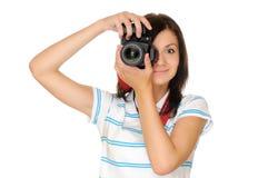Photographer. Teenage girl photographer with camera, isolated on white royalty free stock image