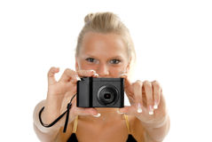 Photographer. Holding out digital camera, studio, shot Stock Images