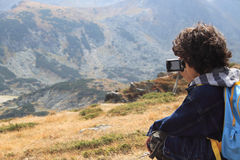 Photographer. Landscape in a high mountain Rila with a little boy photographer Stock Photography