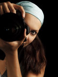 Photographer. Woman professional photographer during work in studio Stock Photography