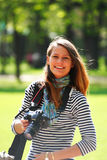 Photographer. The girl-photographer in spring park Royalty Free Stock Photography