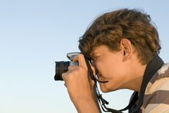 Photographer. Youth with digital camera in hand Royalty Free Stock Images