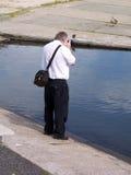Photographer 3. A photographer taking a photograph Stock Photos