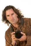 Photographer. Man with long hair holding DSLR photo camera Stock Photography