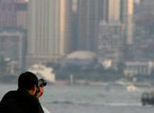 Photographer. Man photographing Hong Kong skyline Royalty Free Stock Image