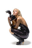 Photographer. Portrait of a beautiful young blond female with camera, isolated on white Royalty Free Stock Image