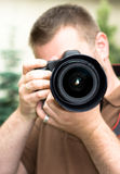 Photographer. Man with photo camera outdoor Royalty Free Stock Images