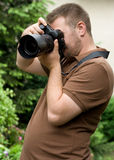 Photographer. Man with camera in the garden Royalty Free Stock Photo
