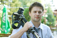 Photographer. Male photograph in green environment Royalty Free Stock Photos