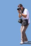 Photographer. With a camera and bags on the blue background Royalty Free Stock Photos