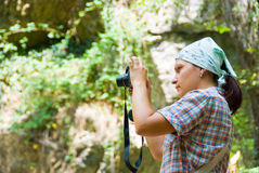 Photographer. Hiker take a picture on a nature Stock Image