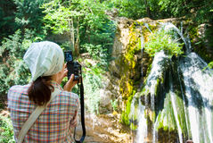 Photographer. Hiker take a picture of waterfall Stock Photography