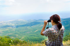 Photographer. Hiker take a picture on a nature Royalty Free Stock Photos