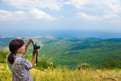Photographer. Hiker take a picture on a nature Royalty Free Stock Images