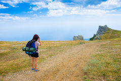 Photographer. Hiker take a picture of landmark - Ghost Valley, Demerdji, Crimea, Ukraine Royalty Free Stock Images