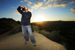 Photographer. Nature photographer taking photo at sunset Royalty Free Stock Photos