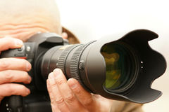 Photographer. A photographer is shooting with a telephoto lens Royalty Free Stock Photo